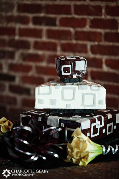 Silver and black triangular wedding cake