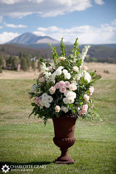 Pink and white floral arrangement for wedding ceremony