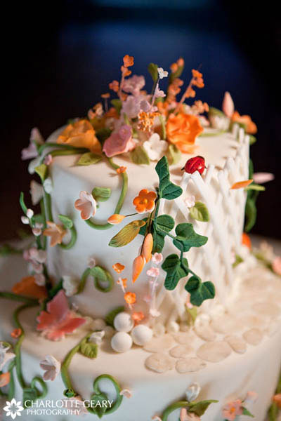 Wedding cake with colorful sugar flowers and lady bugs