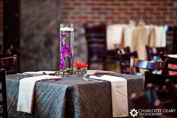 Square wedding table decorated in silver and purple