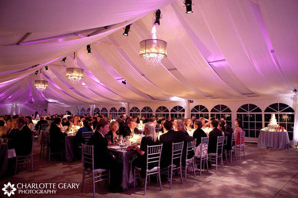 Wedding reception tent with pink up lighting