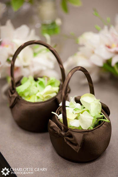 Brown flower girl baskets with green flower petals