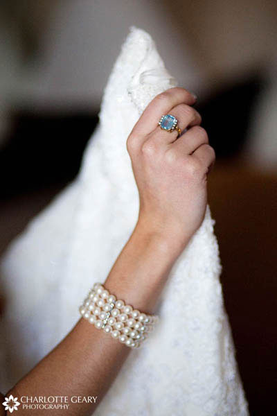 Bride with blue ring and pearl bracelet