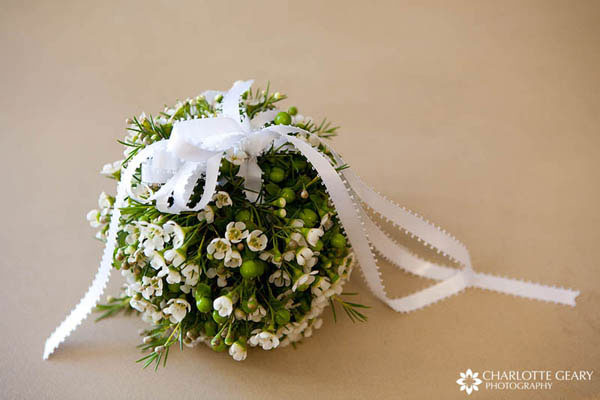 Green and white flower pomander for a flower girl