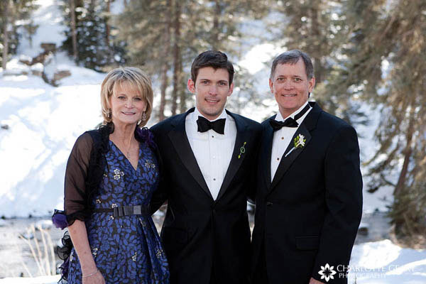 Mother and father of the groom at a winter wedding