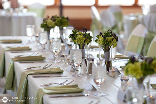 Wedding reception table set in green and white