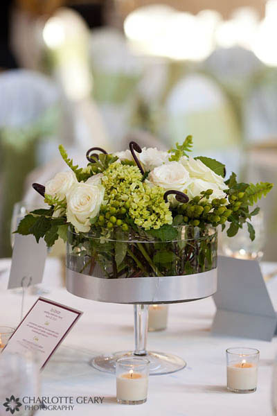 Green centerpiece in a raised glass vase
