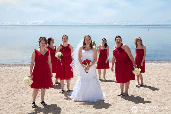 Bridesmaids in red dresses with white bouquets