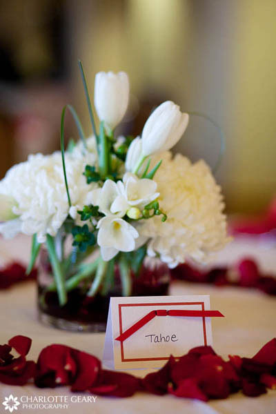 White wedding centerpiece with table name card