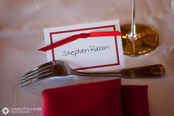 Wedding place card with red ribbon