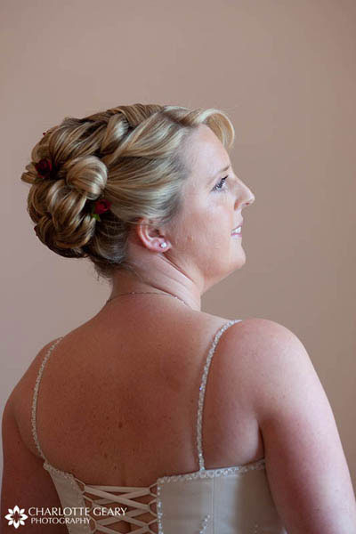 Bride with small red flowers in her hair