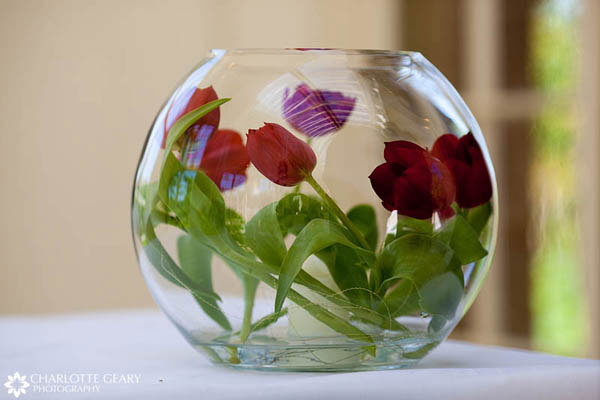 Red tulips in a glass bowl