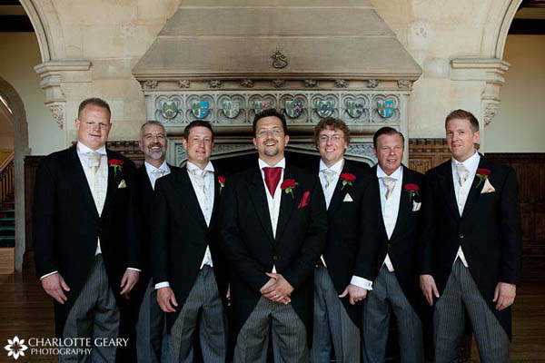 Groom and groomsmen in morning suits with silver ties and red boutonnieres