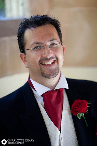 Groom with folded red tie