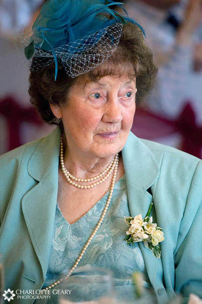 Grandmother in light blue suit and hat