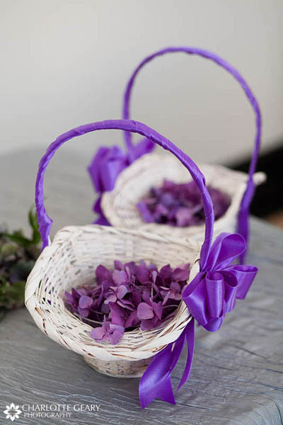 Purple and white flower girl baskets