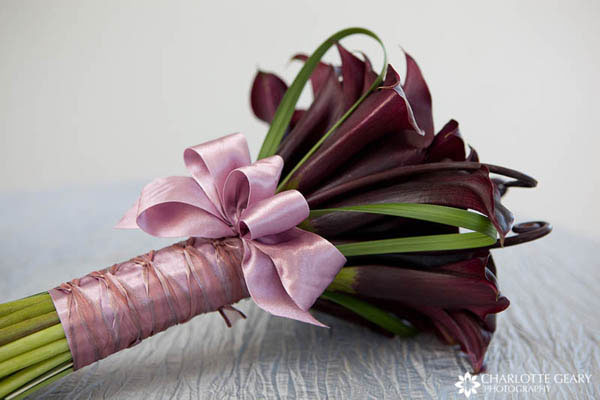 Calla lily bouquet tied with pink ribbons