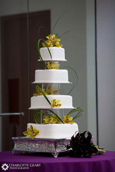 Square wedding cake with yellow orchids