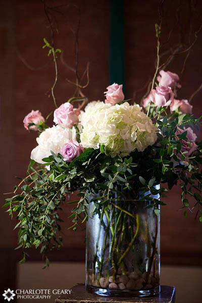 Pink and white flower arrangement for wedding ceremony