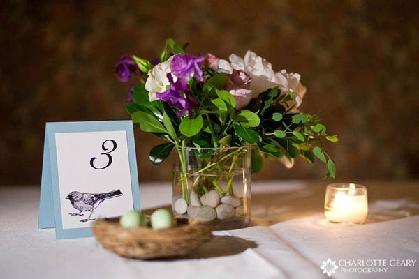Table number sign at a lovebird themed wedding