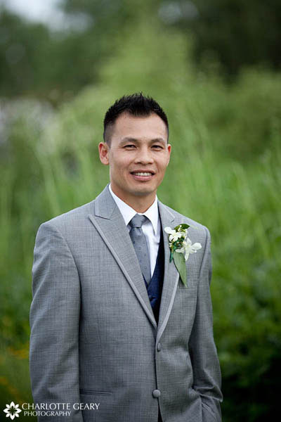 Groom in light gray suit with navy tie and vest