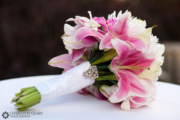 Pink lily bouquet with an heirloom brooch