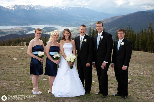 Bridesmaids and groomsmen in blue