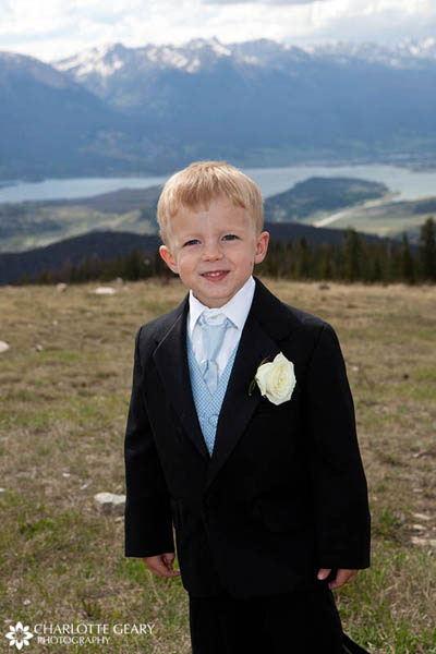 Ring bearer in light blue tie and vest