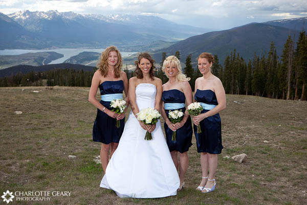 Bridesmaids in strapless navy blue dresses with light blue sashes