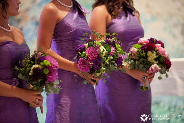 Bridesmaids in purple dresses with purple bouquets