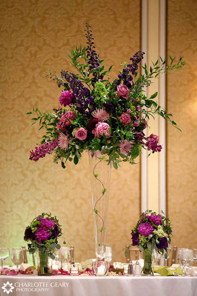 Tall wedding flower vases on pink and purple