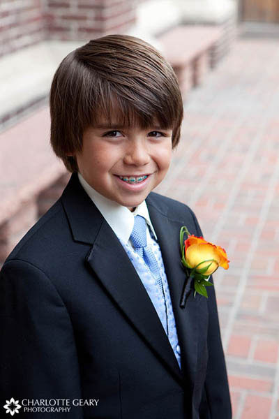 Ring bearer with blue tie and blue braces