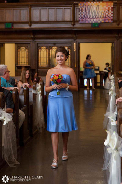 Bridesmaid in strapless blue dress with orange flowers