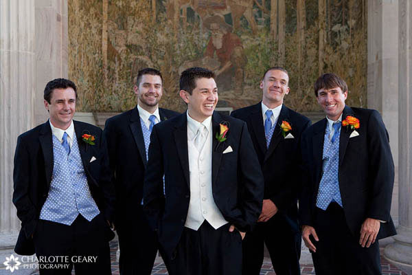 Groomsmen in blue ties and vest with orange boutonnieres