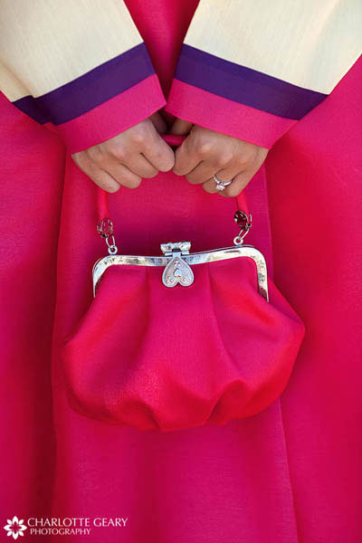 Bride in Korean hanbok wedding dress with matching pink purse