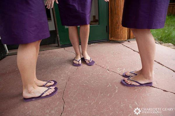 Bridesmaids with purple flip flops