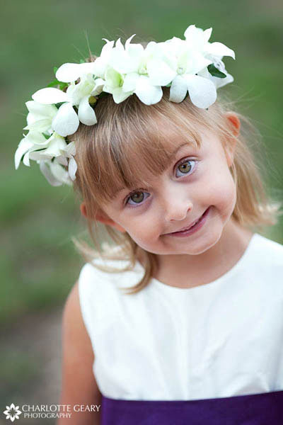 Flower girl with a white head piece garland