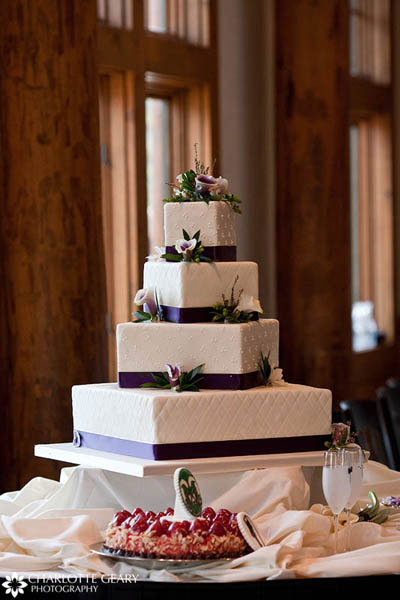 Square wedding cake with purple ribbons and calla lilies