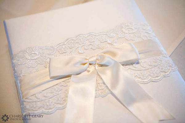 White guest book with bow