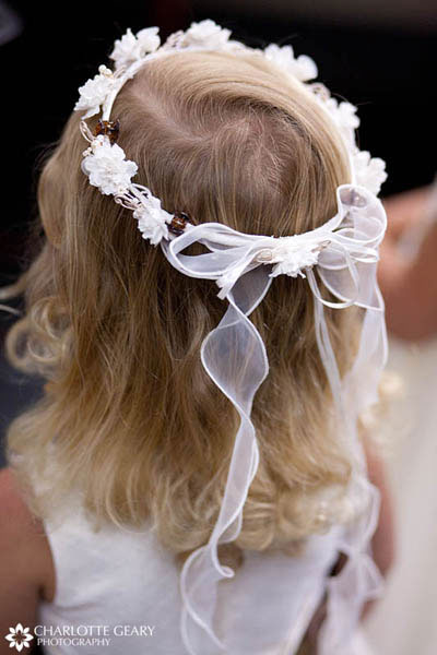 Flower girl with garland in her hair