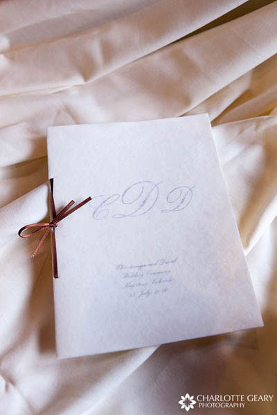 Wedding program tied with a brown ribbon