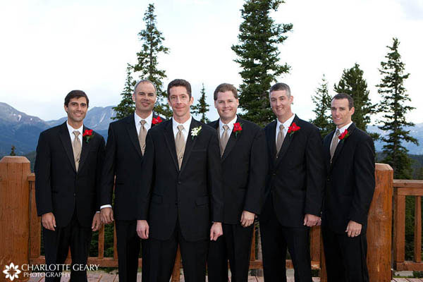 Groomsmen with light brown ties and red boutonnieres