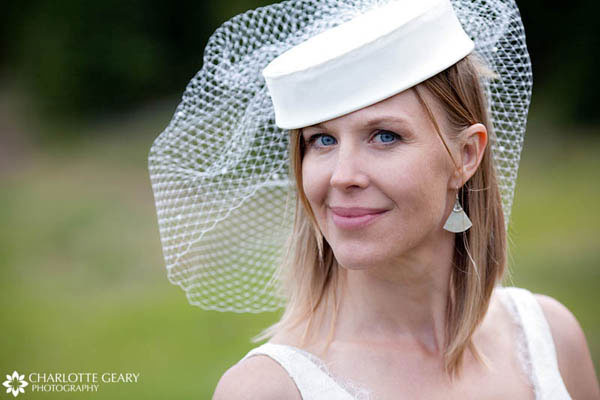 Bride in a hat with a birdcage veil