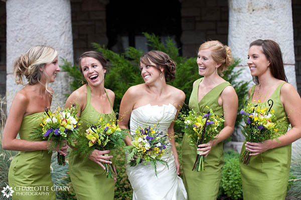 Bridesmaids in green dresses and green and yellow bouquets