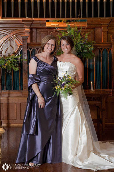 Mother of the bride in blue satin gown