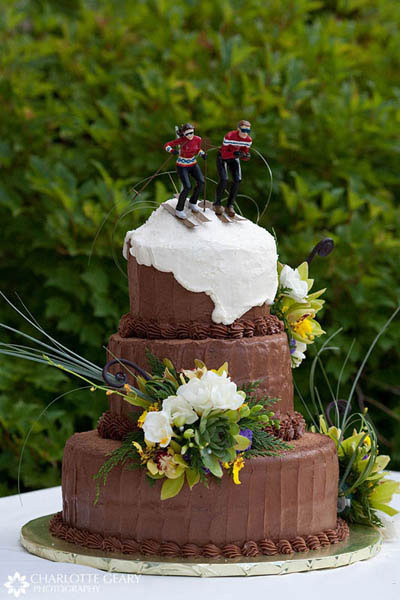 Chocolate wedding cake with ski cake topper