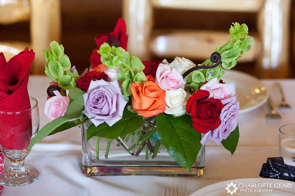 Colorful rose centerpiece in a rectangular vase