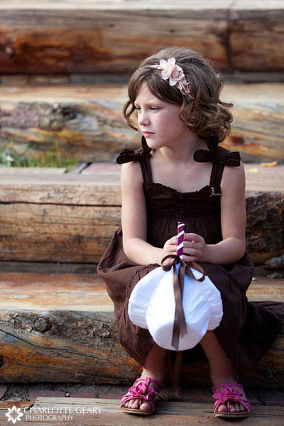 Flower girl with brown dress, pink shoes, and pink headband