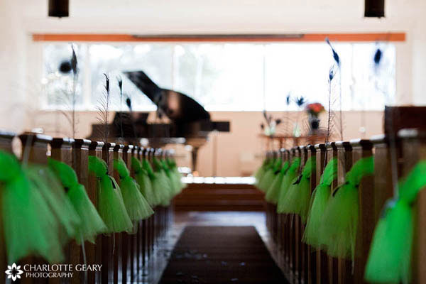 Ceremony decorations with green tulle and peacock feathers