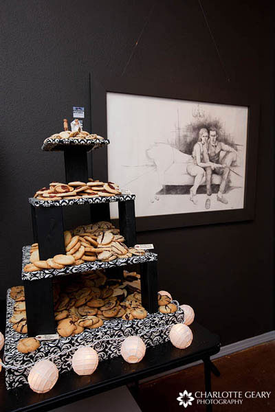 Tower of cookies as a cake alternative, next to a drawing of one of the couple